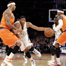 New Orleans Pelicans forward Anthony Davis, second from left, drives as New York Knicks forward Kenyon Martin, left, defends in the first half of an NBA basketball game in New York, Sunday, Dec. 1, 2013. New York Knicks forward Carmelo Anthony (7) and New