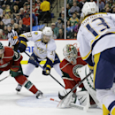 Minnesota Wild goalie Niklas Backstrom, center, of Finland, stops a shot by Nashville Predators center Olli Jokinen (13), of Finland, in front of Wild defenseman Nate Prosser (39) and Predators center Colin Wilson (33) during the second period of an NHL
