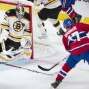Montreal Canadiens left wing Rene Bourque (17) is stopped by Boston Bruins goalie Niklas Svedberg (72) during the second period of an NHL pre-season hockey game, Tuesday, Sept. 23, 2014 in Montreal. The Associated Press