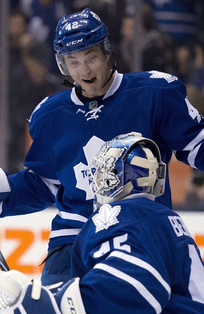 Toronto Maple Leafs Tyler Bozak and goaltender Jonathan Bernier celebrate after defeating the Calgary Flames in NHL hockey action in Toronto on Tuesday April 1, 2014