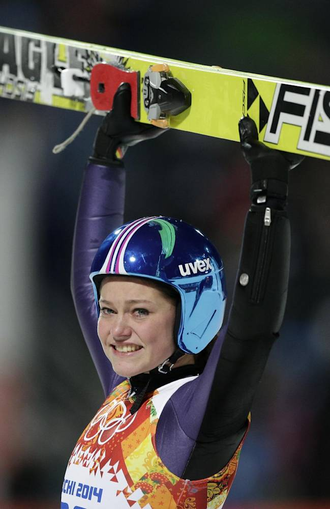Germany's Carina Vogt celebrates winning the gold during the women's normal hill ski jumping final at the 2014 Winter Olympics, Tuesday, Feb. 11, 2014, in Krasnaya Polyana, Russia