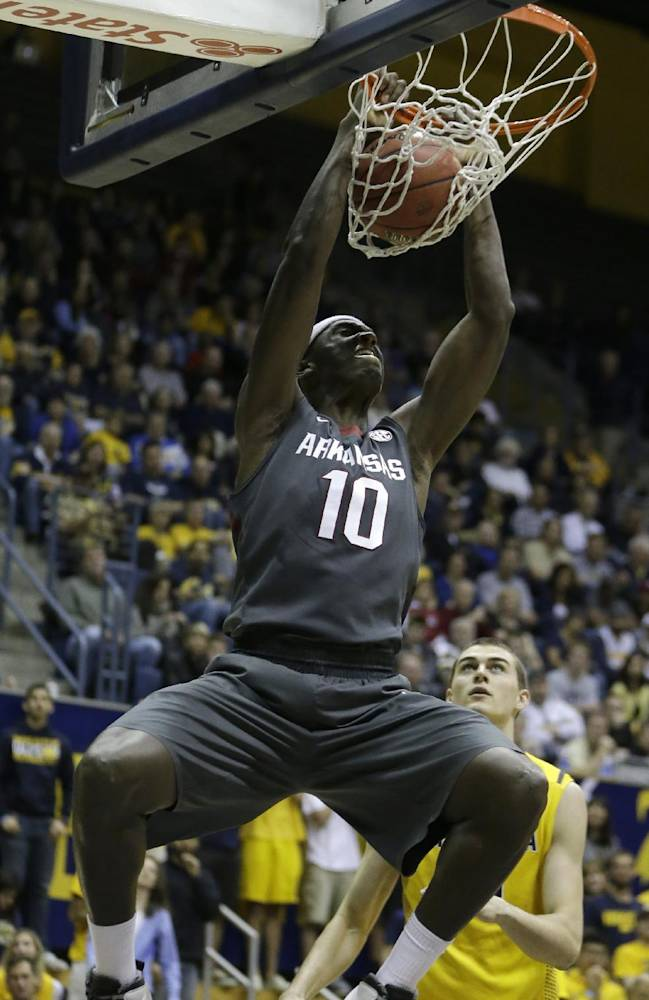 Arkansas forward Bobby Portis (10) scores against California in the first half of an NCAA college basketball game in the NIT tournament Monday, March 24, 2014, in Berkeley, Calif