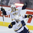 Nashville Predators' Filip Forsberg (9) and Mike Ribeiro (63) celebrate James Neal's goal against the Winnipeg Jets during the third period of an NHL hockey game Friday, Oct. 17, 2014, in Winnipeg, Manitoba The Associated Press