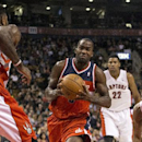 Washington Wizards' Martell Webster, second from left, drives at Toronto Raptors' Amir Johnson, left, during the first half of an NBA basketball game in Toronto on Friday, Nov. 22, 2013 The Associated Press