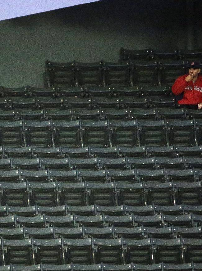 Fans sit in their seats before Game 6 of baseball's World Series between the Boston Red Sox and the St. Louis Cardinals Wednesday, Oct. 30, 2013, in Boston