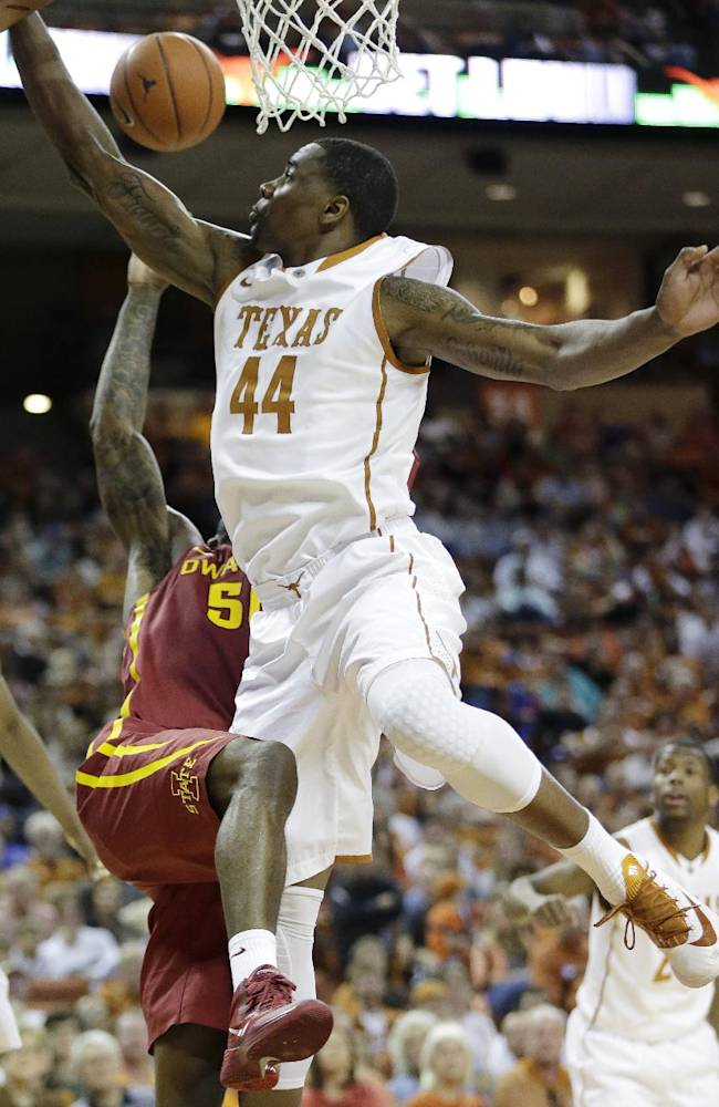 Iowa State's DeAndre Kane, left, is blocked by Texas' Prince Ibeh (44) as he tries to score during the second half on an NCAA college basketball game, Saturday, Jan. 18, 2014, in Austin, Texas. Texas won 86-76
