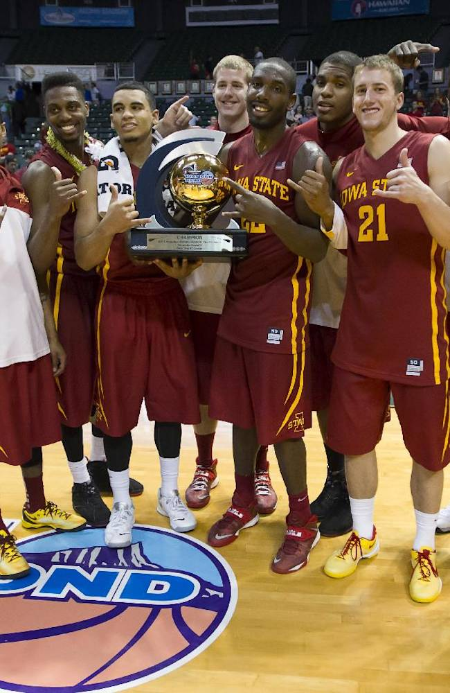 The Iowa State basketball team shows off the Diamond Head Classic championship trophy after defeating Boise State in an NCAA college basketball game Wednesday, Dec. 25, 2013, in Honolulu. Iowa State won 70-66