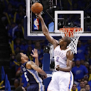Oklahoma City Thunder forward Serge Ibaka (9) blocks a shot from Memphis Grizzlies guard Courtney Lee (5) during the third quarter of Game 1 of the opening-round NBA basketball playoff series in Oklahoma City on Saturday, April 19, 2014. Oklahoma City won