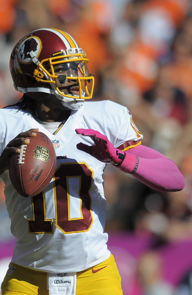 Washington Redskins quarterback Robert Griffin III (10) looks to pass against the Denver Broncos in the first quarter of an NFL football game, Sunday, Oct. 27, 2013, in Denver