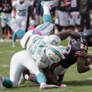 Chicago Bears running back Matt Forte (22) is tackled by Miami Dolphins linebackers Koa Misi and Jelani Jenkins (53) during the first half of an NFL football game Sunday, Oct. 19, 2014 in Chicago The Associated Press