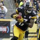 Pittsburgh Steelers wide receiver Mike Wallace (17) runs a reverse during the first quarter of an NFL football game against the San Diego Chargers in Pittsburgh, Sunday, Dec. 9, 2012. The Chargers won 34-24. (AP Photo/Gene J. Puskar)