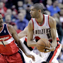 Portland Trail Blazers forward Nicolas Batum, right, from France, looks to pass as Washington Wizards forward Trevor Ariza defends during the first half of an NBA basketball game in Portland, Ore., Thursday, March 20, 2014 The Associated Press