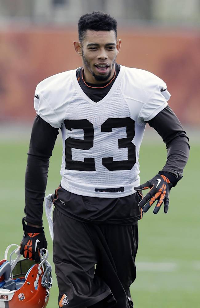 In this May 1, 2014 file photo,Cleveland Browns' Joe Haden (23) walks off the field after a voluntary minicamp workout at the NFL football team's facility in Berea, Ohio. The agent for Haden tells The Associated Press the Browns have signed the Pro Bowl cornerback to a five-year, $68 million contract. Agent Drew Rosenhaus said Monday, May 12, 2014,  that Haden's deal includes $45 million in guaranteed money