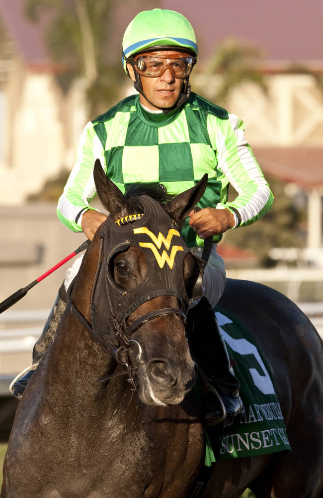 In this image provided by Benoit Photo, Victor Espinoza, top, guides Sunset Slow to the Winner's Circle after their victory in the Grade I, $300,000 Del Mar Debutante horse race Saturday, Aug. 30, 2014, at Del Mar Thoroughbred Club in Del Mar, Calif