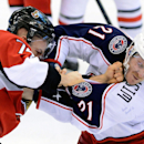 Ottawa Senators' Mark Borowiecki, left, hits Columbus Blue Jackets' James Wisniewski during third period of an NHL hockey game in Ottawa, Ontario, Sunday, Nov. 17, 2013 The Associated Press