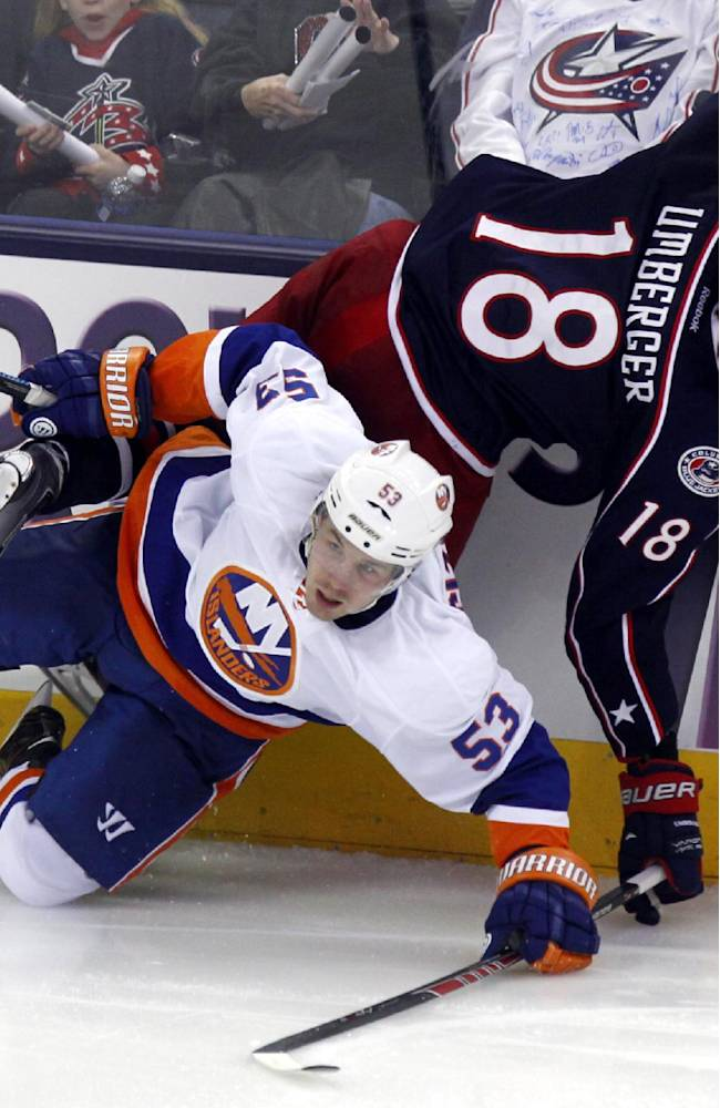Columbus Blue Jackets' R.J. Umberger, top, collides with New York Islanders' Casey Cizikas in the third period of an NHL hockey game in Columbus, Ohio, Sunday, April 6, 2014. The Blue Jackets won 4-0