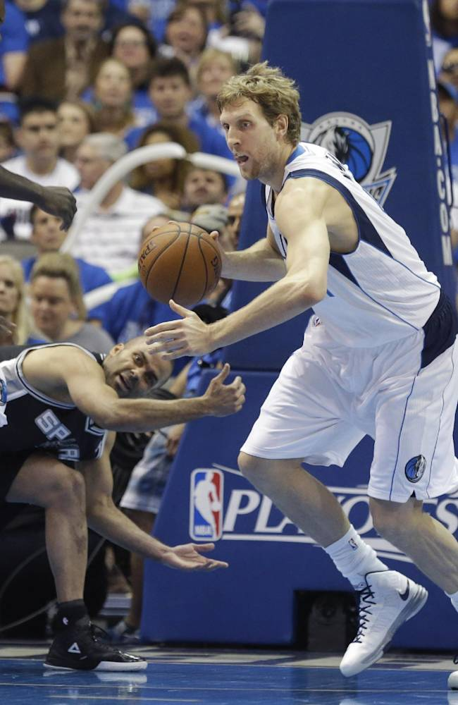 Dallas Mavericks forward Dirk Nowitzki (41) of Germany, comes up with a turnover against San Antonio Spurs guard Tony Parker of France, during the first half in Game 3 in the first round of the NBA basketball playoffs in Dallas, Saturday, April 26, 2014