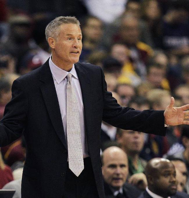 Philadelphia 76ers' head coach Brett Brown instructs his team against the Cleveland Cavaliers during the second quarter of an NBA preseason basketball game Monday, Oct. 21, 2013, in Columbus, Ohio