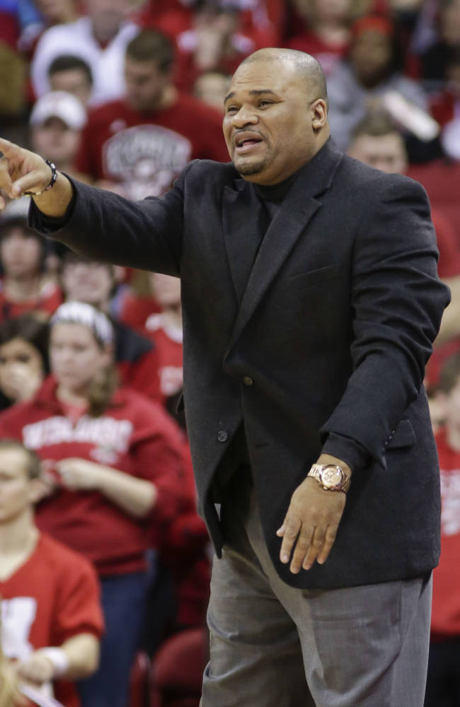 Prairie View coach Byron Rimm directs his team during the second half of an NCAA college basketball game against Wisconsin Saturday, Dec. 28, 2013, in Madison, Wis. Wisconsin won 80-43