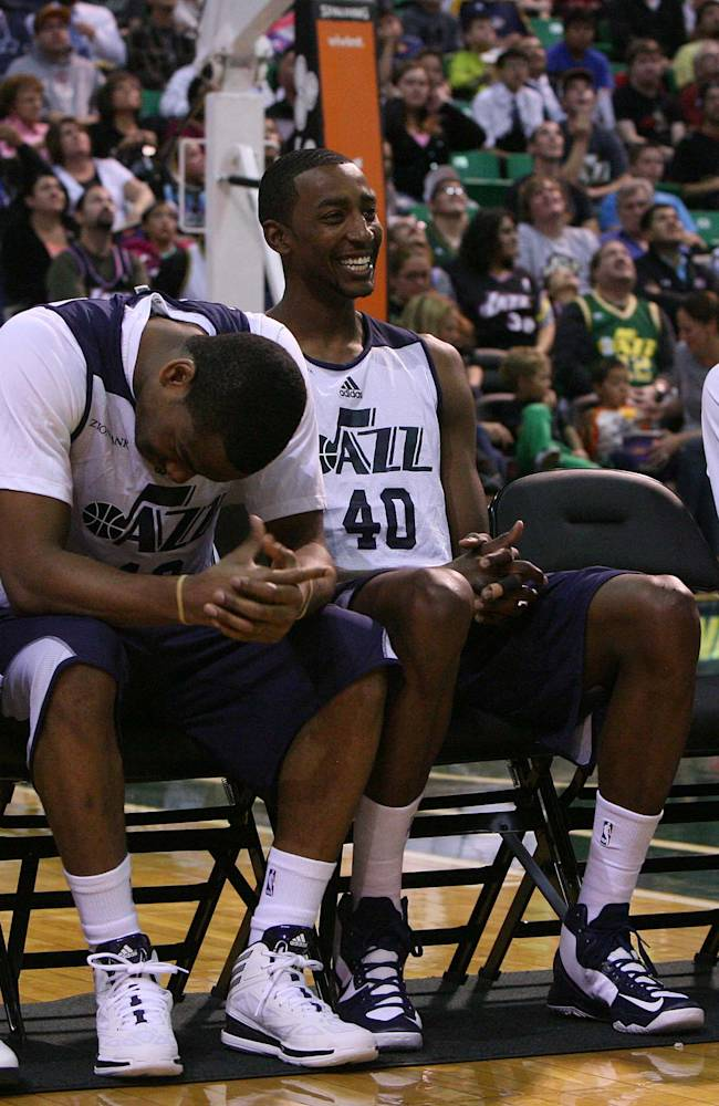 From left: Gordon Hayward, Alec Burks, Jeremy Evans and Dominic McGuire share a laugh during player introductions. Utah Jazz fans filled EnergySolutions Arena to get a glimpse at this year's players during the annual scrimmage Saturday, Oct. 5, 2013. The Jazz roster currently includes 20 players, but NBA rules require that that number must be reduced to 15 by opening night, Oct. 30 against Oklahoma City