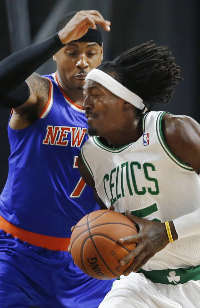 Boston Celtics forward Gerald Wallace drives against New York Knicks forward Carmelo Anthony (7) during the first half of a preseason NBA basketball game in Providence, R.I., Wednesday, Oct. 9, 2013