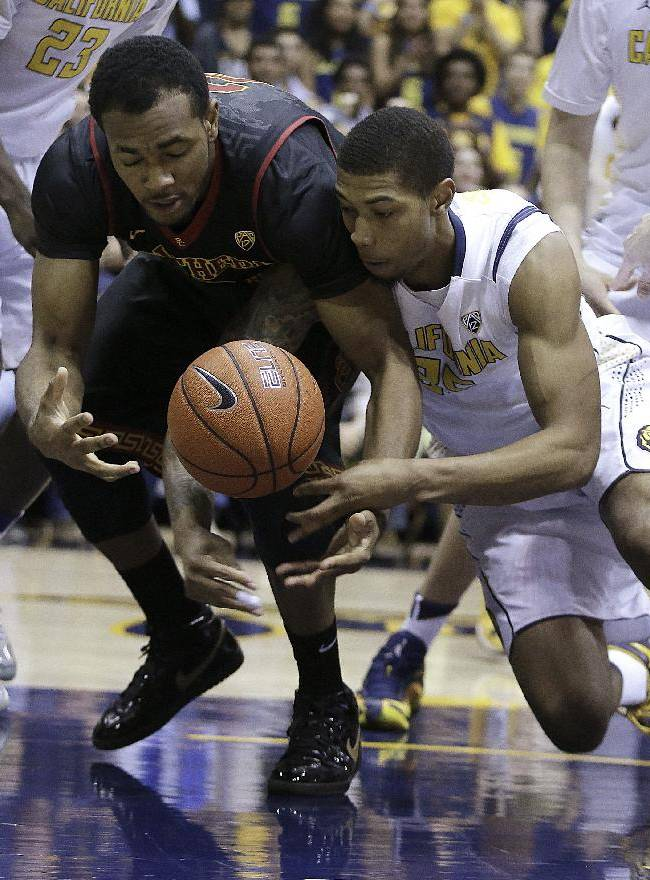 Southern California's Roschon Prince, left, and California's Richard Solomon fight for a loose ball in the first half of an NCAA college basketball game, Sunday, Feb. 23, 2014, in Berkeley, Calif