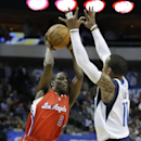Los Angeles Clippers guard Darren Collison (2) jumps to pass against Dallas Mavericks guard Monta Ellis (11) during the first half of an NBA basketball game Thursday, March 27, 2014, in Dallas The Associated Press