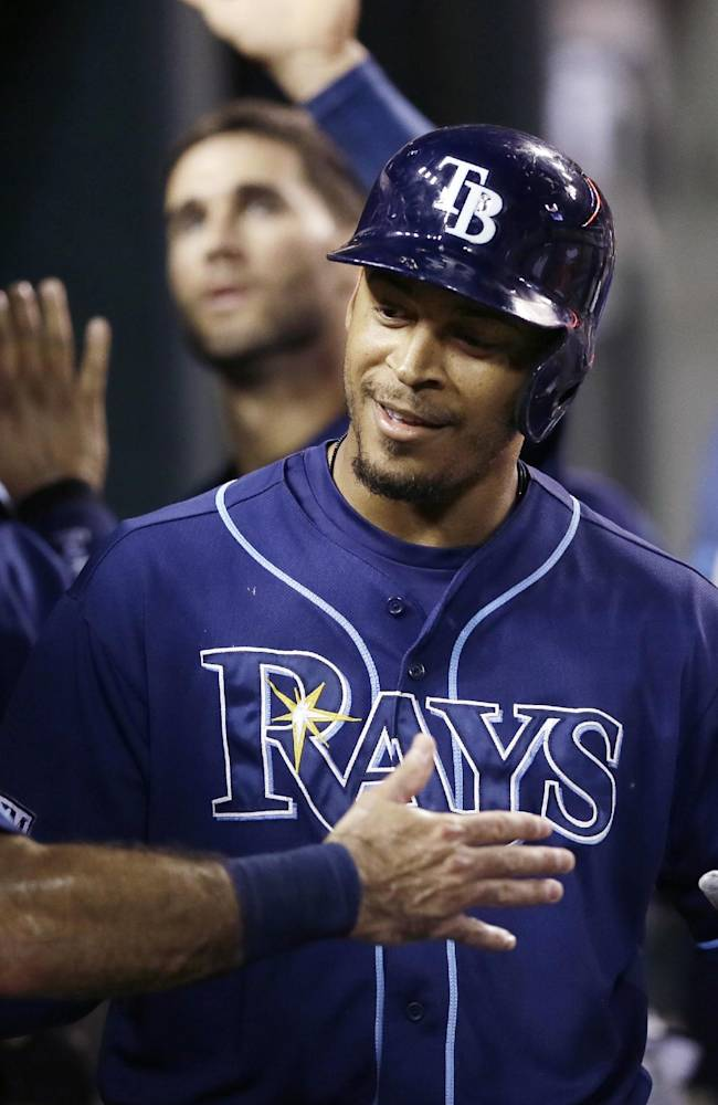 Tampa Bay Rays' Desmond Jennings is congratulated after his two-run home run off Detroit Tigers pitcher Rick Porcello during the sixth inning of a baseball game in Detroit, Sunday, July 6, 2014. (AP Photo/Carlos Osorio)
