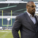 FILE - In this Sept. 19, 2013, file photo, former Philadelphia Eagles quarterback Donovan McNabb pauses during a television interview before an NFL football game against the Kansas City Chiefs, in Philadelphia. McNabb has been arrested again in Arizona on suspicion of driving while under the influence. Police in the Phoenix suburb of Gilbert said Tuesday, July 7, 2015, that McNabb was cited and released from a police facility after being arrested June 28, 2015, following a non-injury collision late that night. (AP Photo/Julio Cortez, File)