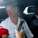 Spanish striker Fernando Torres, left, sits next to AC Milan CEO Adriano Galliani shortly after arriving at Linate airport, Milan, Italy, Saturday, Aug. 30, 2014. Chelsea has agreed terms with AC Milan for Torres to join the Serie A club in a two-year loa