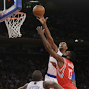 New York Knicks' Metta World Peace blocks a shot by Houston Rockets' James Harden, right, as Knicks' Raymond Felton, left, defends during the second half of an NBA basketball game Thursday, Nov. 14, 2013, in New York. The Rockets won 109-106 The Associate
