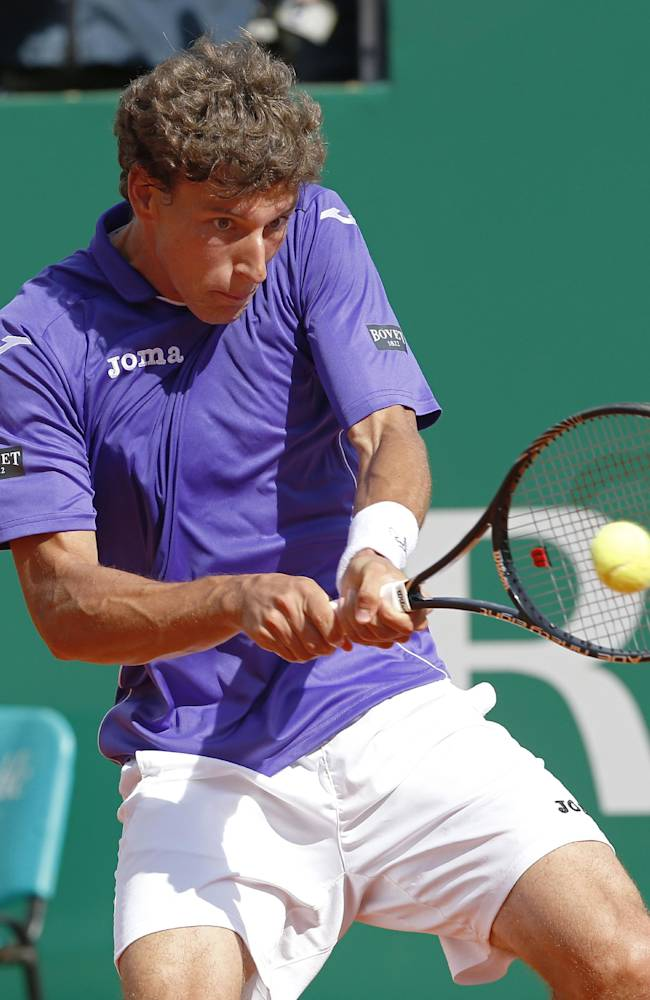 Pablo Carreno Busta of Spain returns the ball to Novak Djokovic of Serbia during their third round match of the Monte Carlo Tennis Masters tournament in Monaco, Thursday, April 17, 2014. Djokovic won 6-0, 6-1