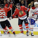 Chicago Blackhawks defenseman Michal Rozsival (32), center, celebrates with left wing Bryan Bickell (29) as Montreal Canadiens center Manny Malhotra (20) reacts during the first period of an NHL hockey game in Chicago, Friday, Dec. 5, 2014 The Associated