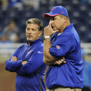 In this Oct. 5, 2014, file photo, Buffalo Bills head coach Doug Marrone, right, and defensive coordinator Jim Schwartz talk before the Bills play the Detroit Lions in an NFL football game in Detroit. The Associated Press will honor an NFL assistant coach