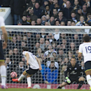 Tottenham Hotspur's Andros Townsend, center, shoots to score from the penalty spot, past Leicester City's Mark Schwarzer during the English FA Cup fourth round soccer match between Tottenham Hotspur and Leicester City, at White Hart Lane, London, Saturday