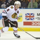Chicago Blackhawks Duncan Keith moves the puck against the Edmonton Oilers during the first period of a preseason NHL hockey game Sunday, Sept. 28, 2014, in Saskatoon, Saskatchewan. The Blackhawks won 5-0. The Associated Press