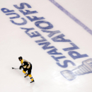 Boston Bruins' Patrice Bergeron warms up for Game 1 of a first-round NHL playoff hockey series against the Detroit Red Wings in Boston on Friday, April 18, 2014 The Associated Press