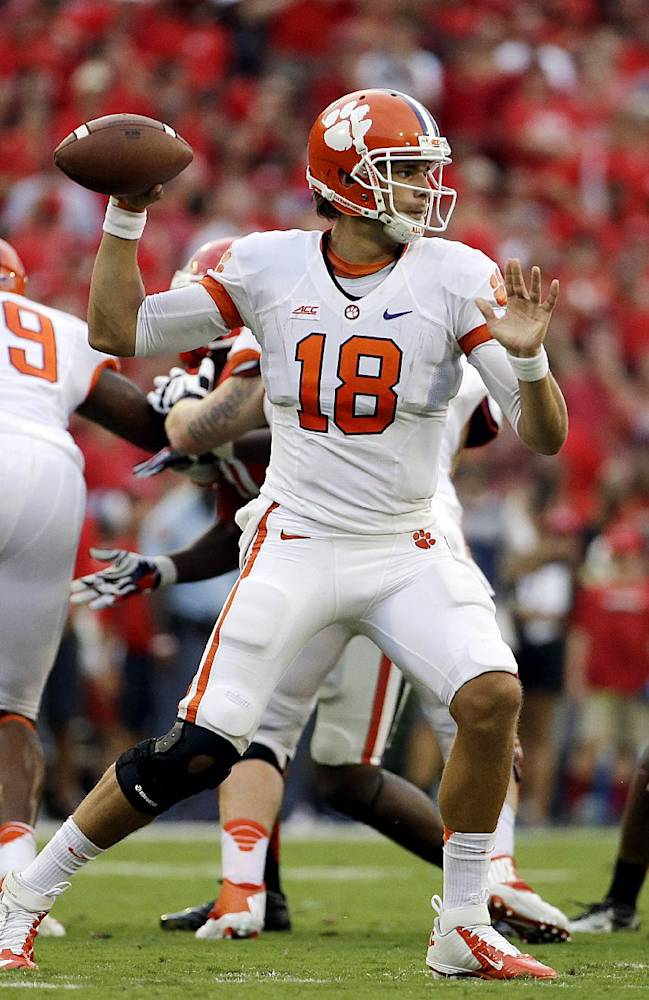 Clemson quarterback Cole Stoudt looks to pass the ball in the first half of an NCAA college football game against Georgia, Saturday, Aug. 30, 2014, in Athens, Ga