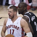 Toronto Raptors forward Jonas Valanciunas, left, reacts in front of Brooklyn Nets forward Kevin Garnett during the first half of Game 2 in an NBA basketball first-round playoff series, Tuesday, April 22, 2014, in Toronto The Associated Press