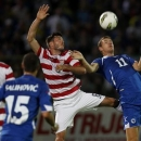 Bosnia's Edin Dzeko (R) fights for the ball against Brad Evans of the U.S. during their international friendly soccer match in Sarajevo, August 14, 2013. REUTERS/Dado Ruvic