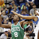 Boston Celtics' Jeff Green, left, reaches for a pass as Minnesota Timberwolves' Corey Brewer defends in the first quarter of an NBA basketball game on Saturday, Nov. 16, 2013, Minneapolis The Associated Press