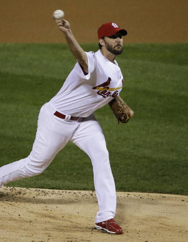 St. Louis Cardinals starting pitcher Adam Wainwright throws during the first inning of Game 5 of baseball's World Series against the Boston Red Sox, Monday, Oct. 28, 2013, in St. Louis