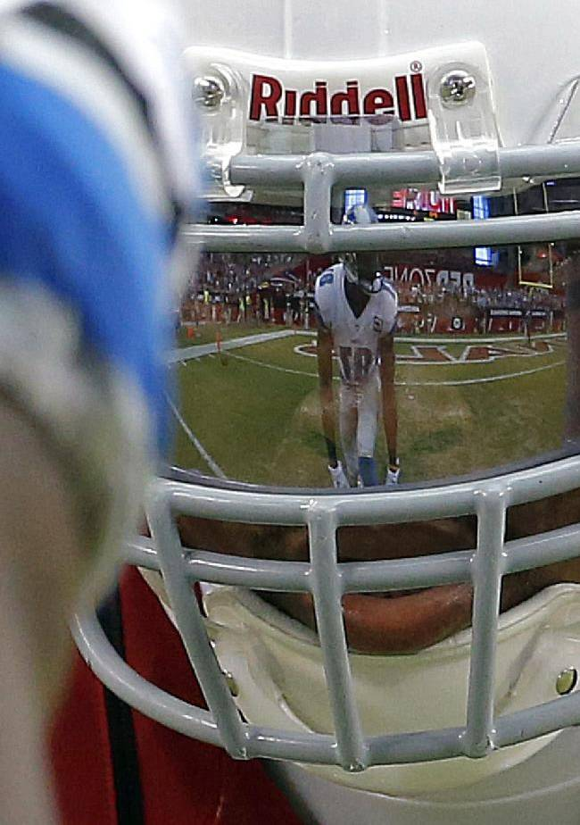 CORRECTS TO PATRICK PETERSON -Detroit Lions wide receiver Calvin Johnson is reflected in the face mask of Arizona Cardinals defensive back Patrick Peterson during the second half of a NFL football game, Sunday, Sept. 15, 2013, in Glendale, Ariz