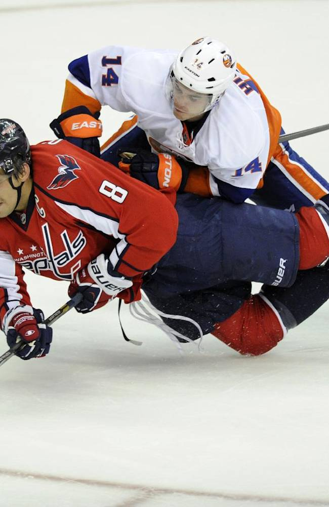 Washington Capitals right wing Alex Ovechkin (8), of Russia, goes for the puck against New York Islanders defenseman Thomas Hickey (14) during the third period an NHL hockey game, Tuesday, Nov. 5, 2013, in Washington. The Capitals won 6-2
