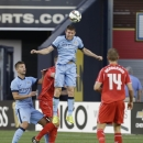Manchester City's James Milner heads the ball in the first half of a Guinness International Champions Cup soccer tournament match against the Manchester City Wednesday, July 30, 2014, in New York