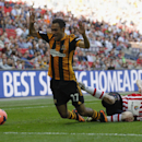 Hull City's Ahmed Elmohamady, left, is tackled by Sheffield United's Jamie Murphy during their English FA Cup semifinal soccer match at Wembley Stadium in London, Sunday, April 13, 2014