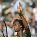 France's Gael Monfils celebrates winning the second round match of the French Open tennis tournament against Argentina's Diego Schwarztman at the Roland Garros stadium, in Paris, France, Wednesday, May 27, 2015. Monfils won in five sets 4-6, 6-4, 4-6, 6-2, 6-3. (AP Photo/David Vincent)