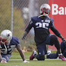 New England Patriots cornerbacks Kyle Arrington (25) and Alfonzo Dennard (37) stretch before practice begins at the NFL football team's facility Wednesday, Oct. 29, 2014 in Foxborough, Mass. The Patriots (6-2) will play the Denver Broncos (6-1) Sunday in
