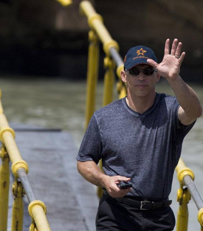 Joe Girardi manager of the New York Yankees waves to the crowd during a visit to the Miraflores Locks at the Panama Canal in Panama City, Friday, March  14, 2014. The New York Yankees and the Miami Marlins will play on March 15-16, in the