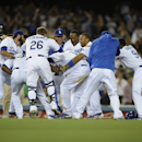 Los Angeles Dodgers' Carl Crawford, center, celebrates with his team after hitting walk off double during the 10th inning of a baseball game against the Detroit Tigers in Los Angeles, Tuesday, April 8, 2014. The Los Angeles Dodgers won 3-2 The Associated